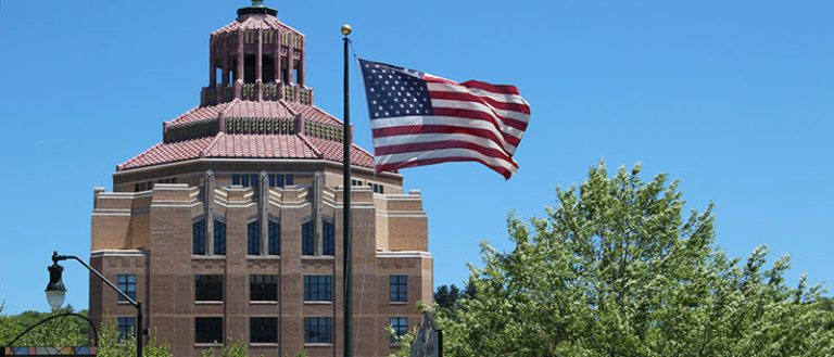 American flag in front of Asheville City Hall.