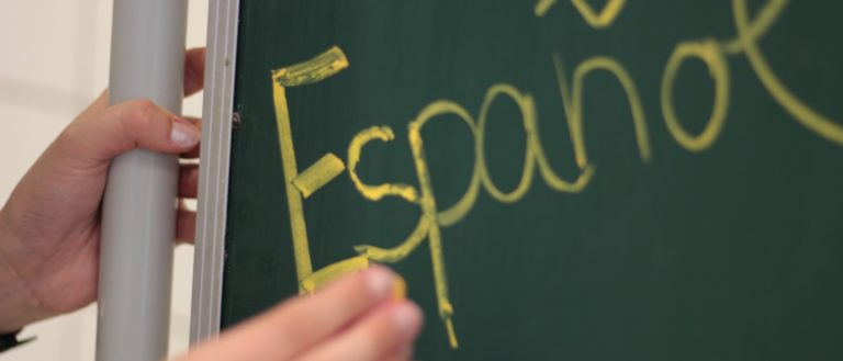 The word 'Espanol' written on a chalkboard.
