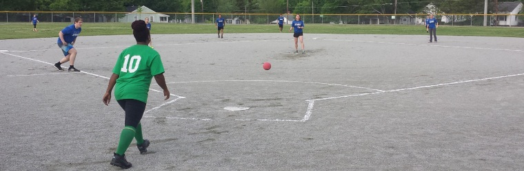 A person about to kick an incoming kickball.