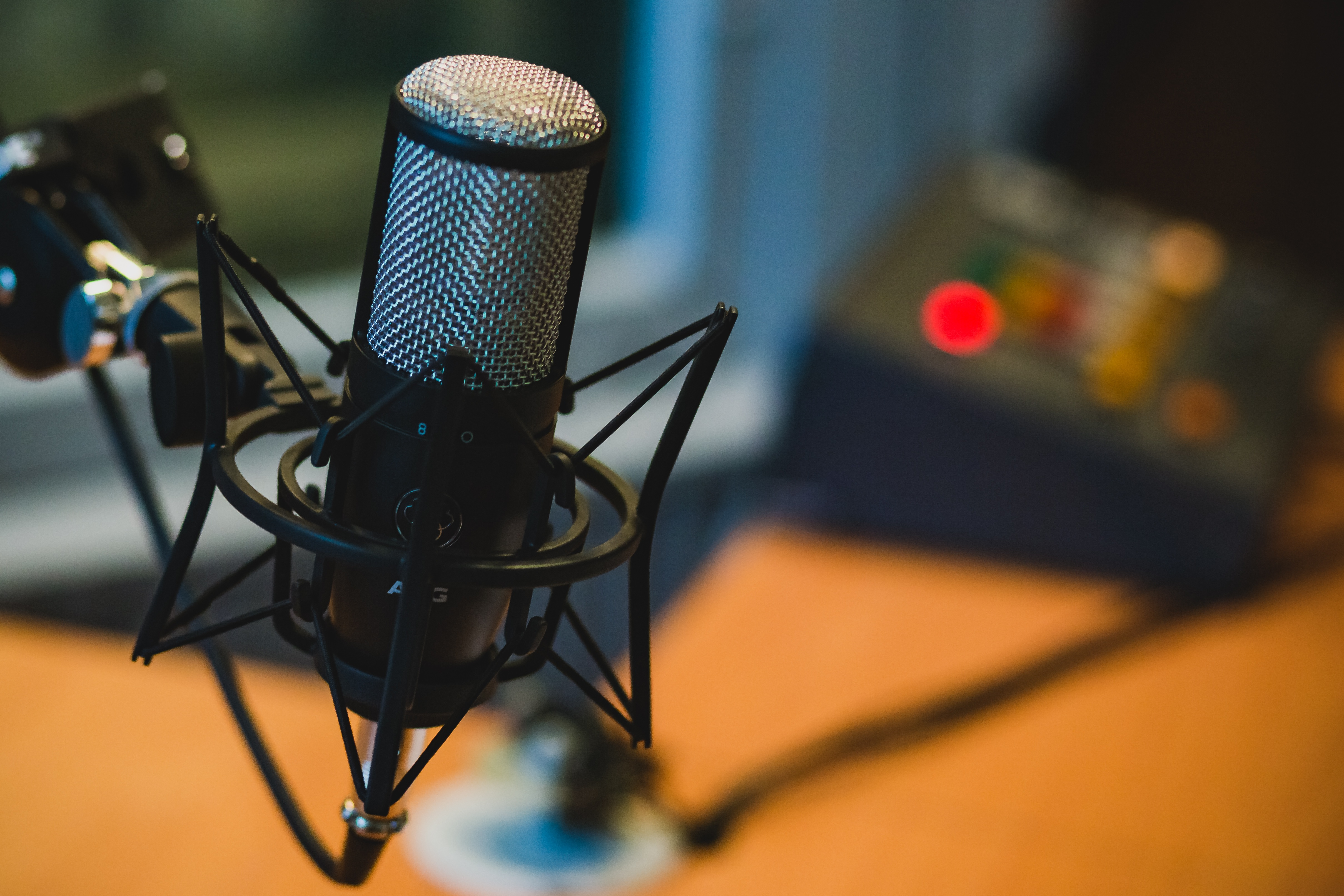 studio microphone in a podcast recording room.