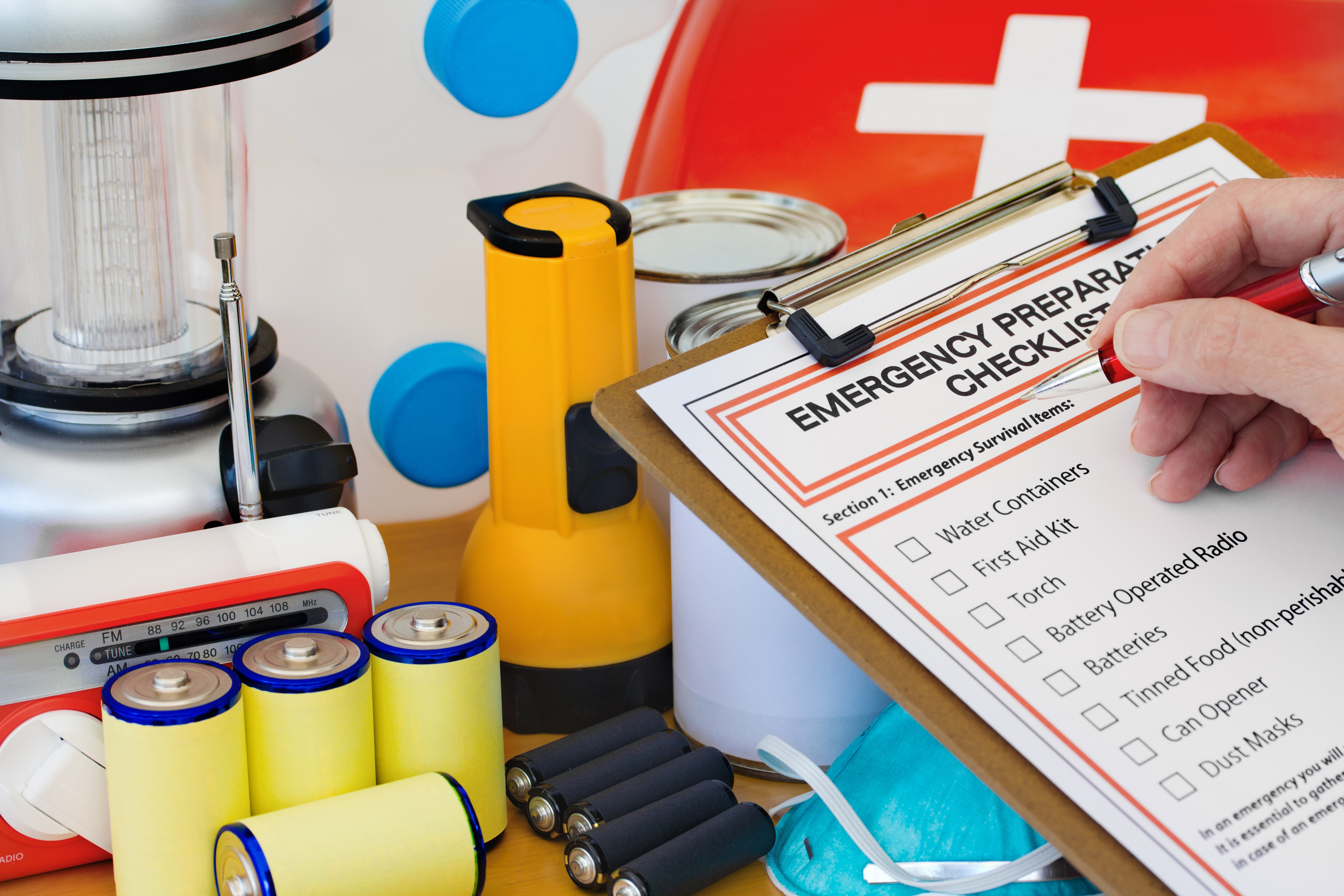 A person completing an emergency preparation list.