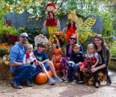 A family taking a Halloween portrait at WNC Nature Center.
