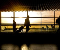 A group of passengers walking through an airport terminal.