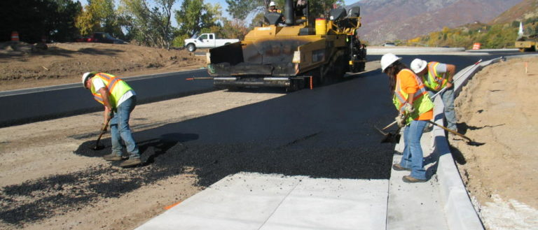 Construction workers improving a closed road.