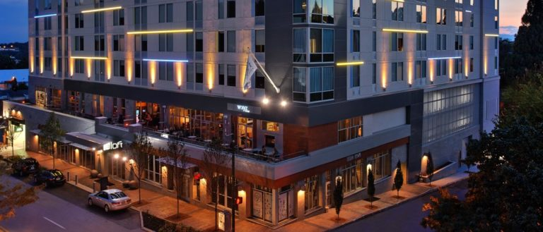 The exterior of Aloft Asheville Downtown at night.