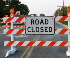 "A road closure sign reading ""road closed."""