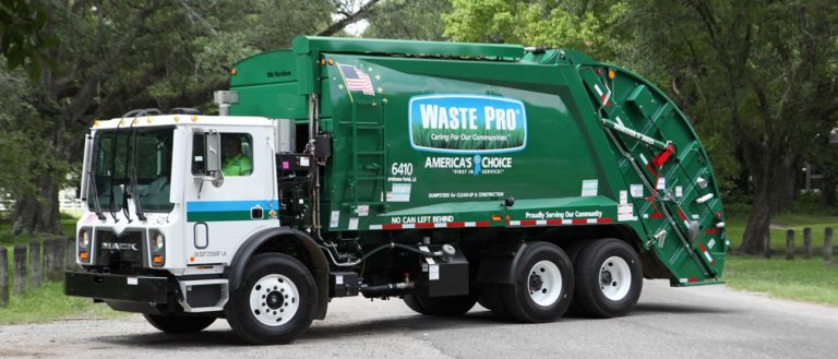 A green Waste Pro garbage truck.