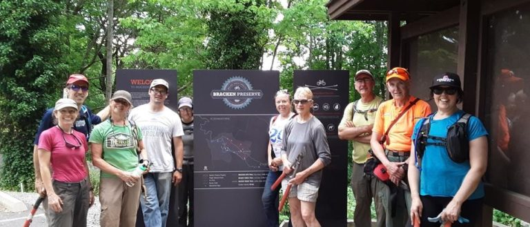 Volunteers and officials celebrating the opening of the Pinnacle Trail at Bracken Mountain Preserve.