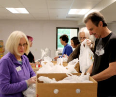 MANNA volunteers pack MANNA Packs for Kids food bags to send home with kids on Friday afternoons.