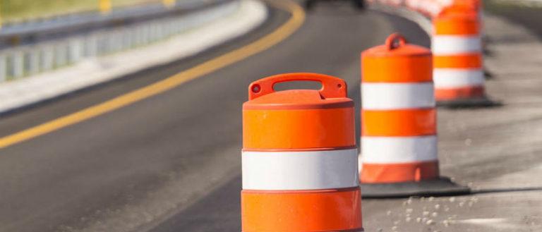 Construction cones following a road.