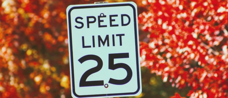A speed limit sign that reads 25 miles per hour.