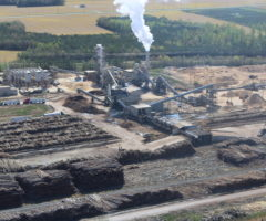 A large biomass production facility releasing steam.