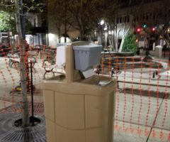 A portable handwashing station in a city plaza.