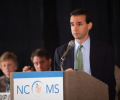 A man speaking at a podium.