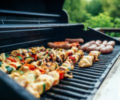 Kebabs and sausages on a hot grill.