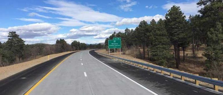 A two lane interstate highway road.