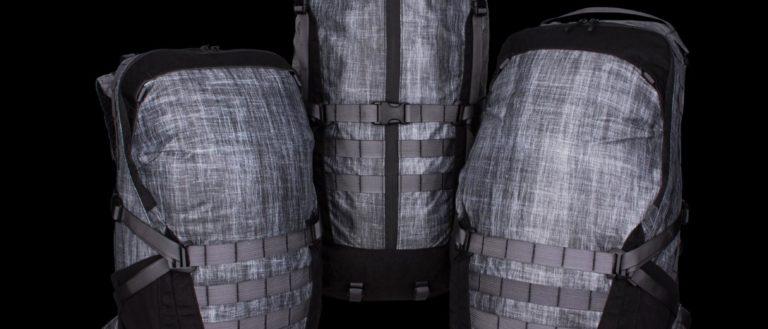 Three gray-colored backpacks.