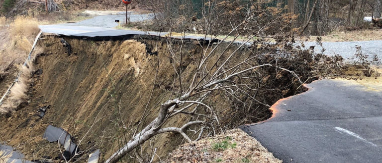 A broken road caused by a slide.