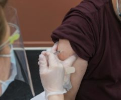 A person receiving a vaccination in their arm.