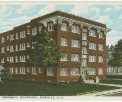 A postcard of a brick apartment building.