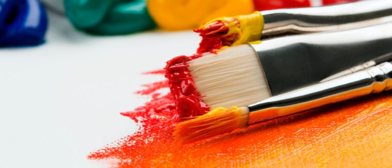 Paint brushes on a canvas.