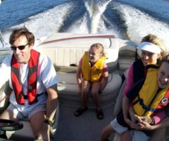 A family of four in a boat.