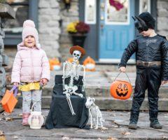 Two children wearing Halloween costumes.