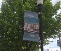 An ArtScape banner hanging on a light post in downtown Hendersonville.