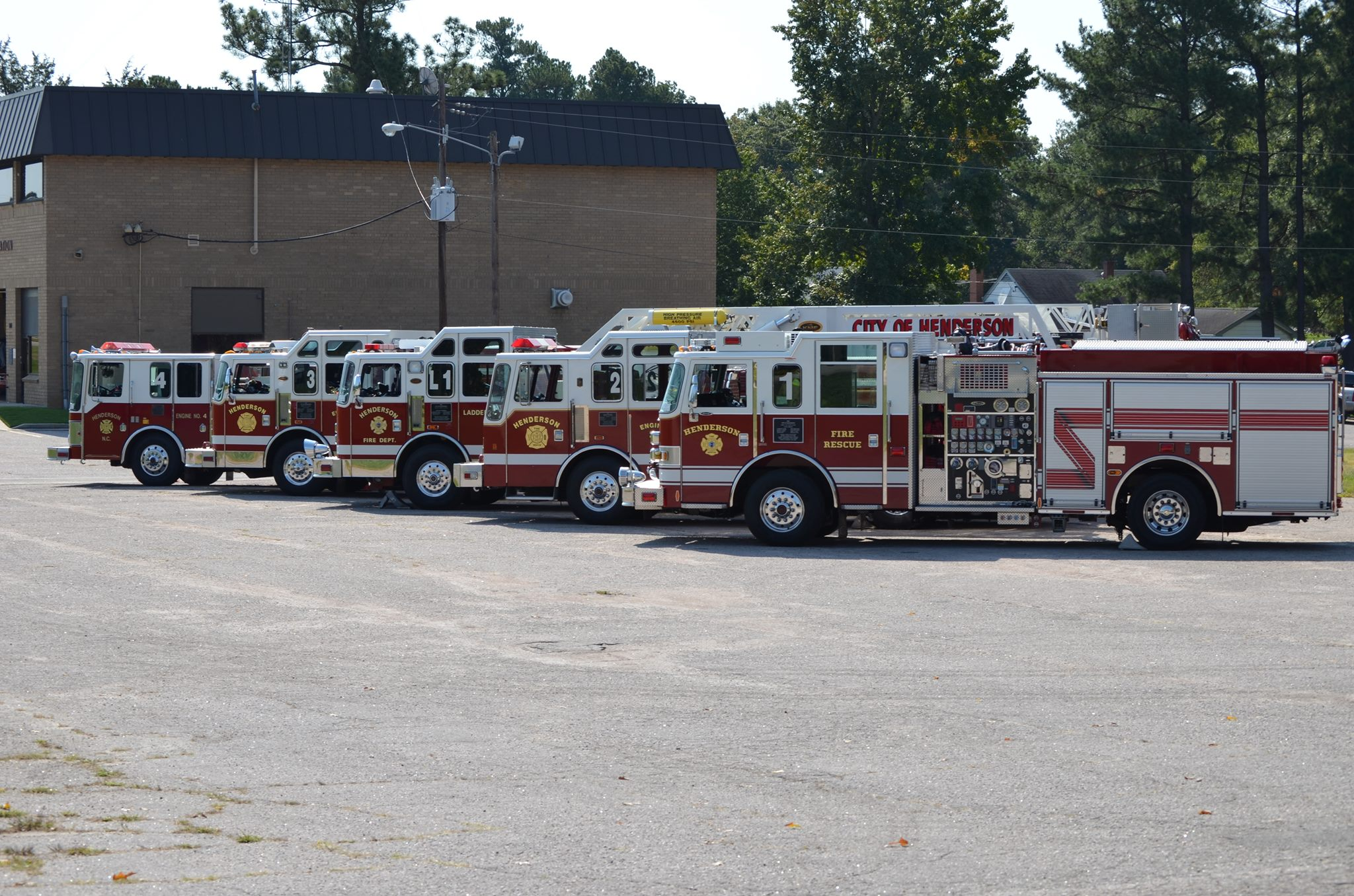 The City of Hendersonville Fire Department engines in a parking lot.