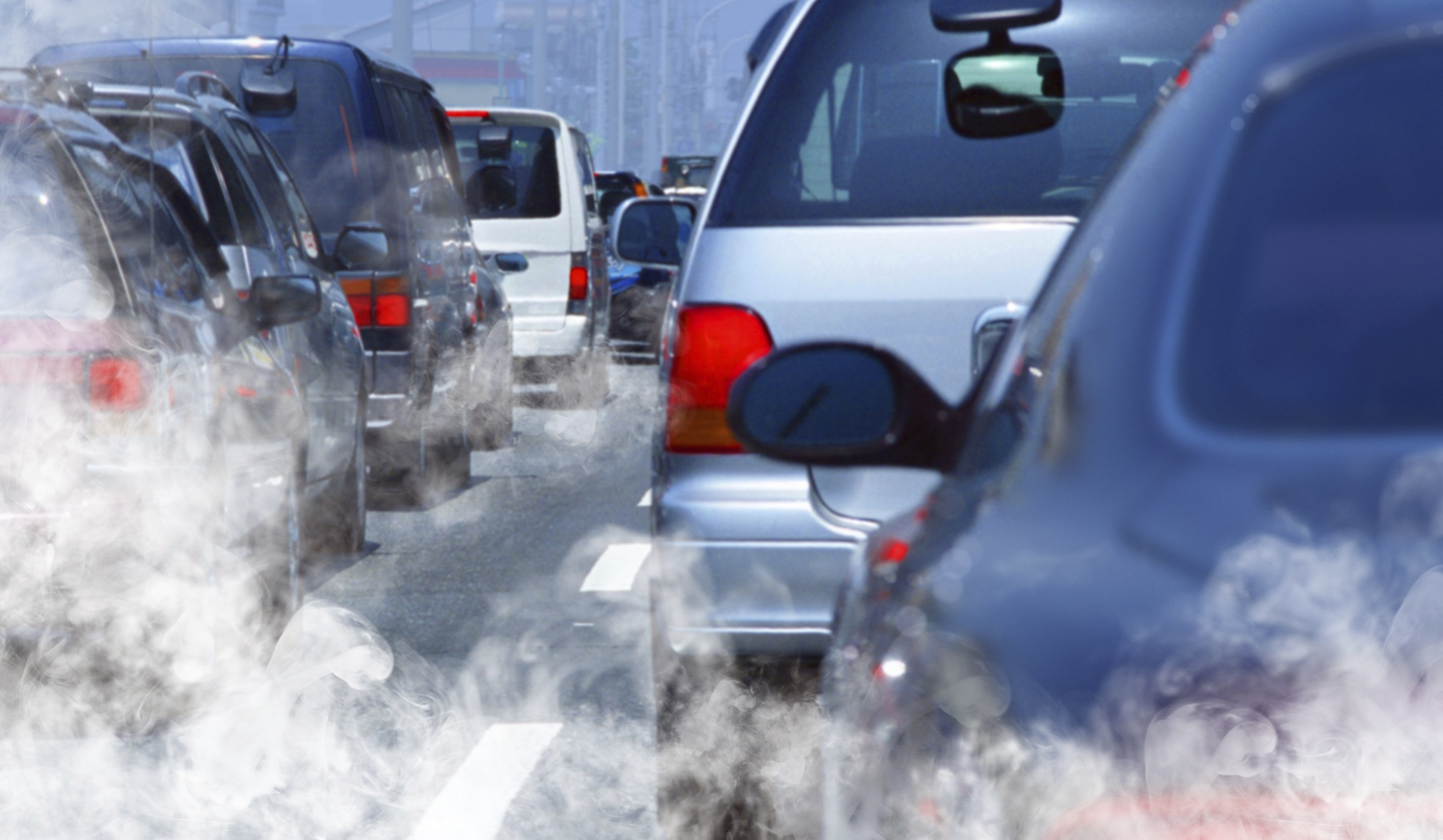 Cars in traffic producing smog.