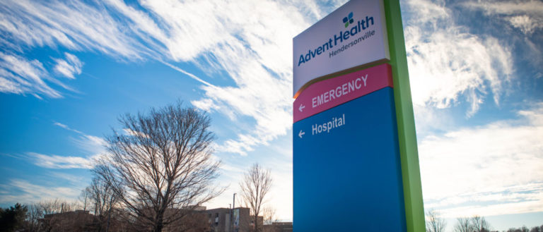 Signage in front of the AdventHealth Hendersonville hospital.