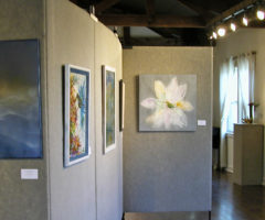 An art gallery showing pieces from an Arts Council of Henderson County exhibit.