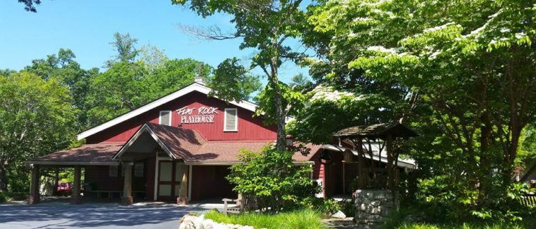 The exterior of Flat Rock Playhouse on a sunny day.