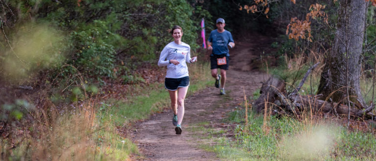 Two runners on a mountain trail during the Smoky Mountain Relay.