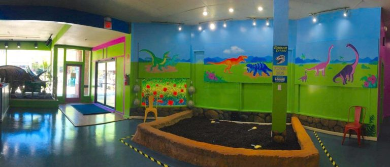 Dinosaur art work and exhibits in the Hands On! Children's Museum.