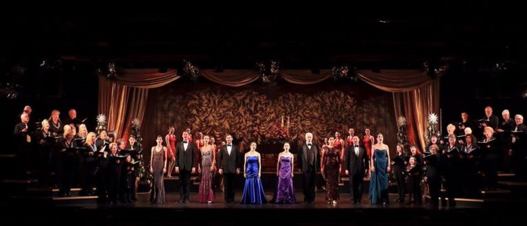 Actors on stage during a curtain call.