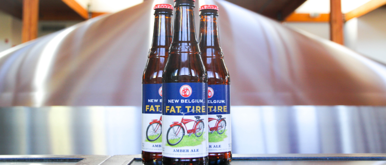Three Fat Tire beer bottles in a brewery.