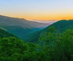 A wide view of the Blue Ridge Mountains at sunset.