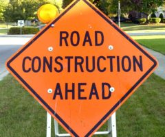 """A road sign that reads, """"road construction ahead."""""""