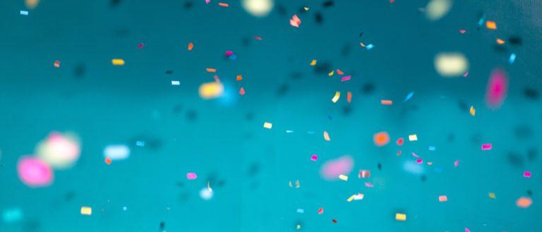 Confetti thrown in a blue room.