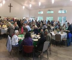 A large room of people during an Empty Bowls fundraiser