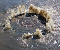 Sewage spilling out of a manhole.