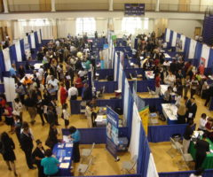 A conference center filled with career fair booths.