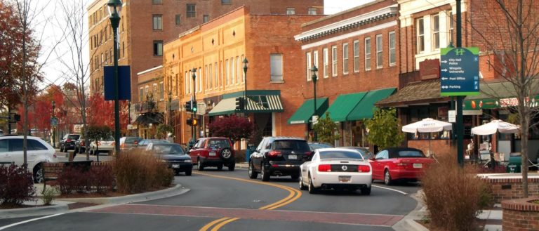 Cars driving through downtown Hendersonville.