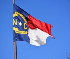 The state flag of North Carolina on a pole.