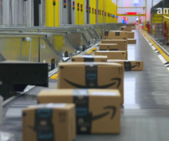 Amazon packages on a conveyer belt.