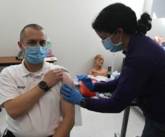A person receiving a vaccination shot.