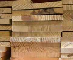 Pieces of wood stacked on one another.
