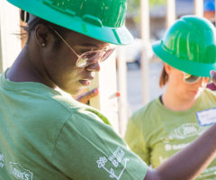 A Habitat for Humanity volunteer working on a home.
