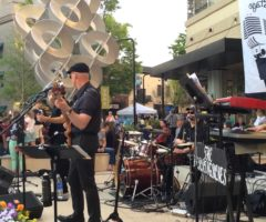 A band performing on the CPI Security Stage at Greenville Heritage Main Street Fridays.